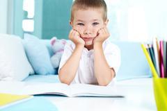 Kid not feeling like doing his homework Stock Photos