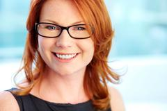Close-up shot of a wonderful red-haired woman with a pleasant smile Stock Photos
