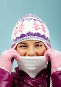 Face of pretty woman in knitted winter cap and gloves looking at camera Stock Photos