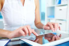 Image of female hands touching screen of digital tablet Stock Photos