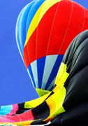 partially inflated hot air balloons - stock photo