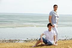 Gay guys being by water at low tide Stock Photos