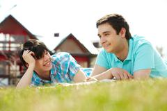 Gay couple spending summer vacation together in the country Stock Photos
