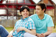 homosexual couple having good time on a warm summer day - stock photo