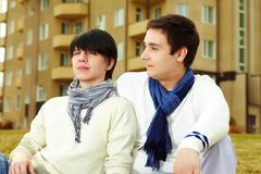 close-up portrait of a homosexual couple spending time together outdoors - stock photo