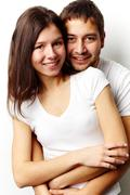 Vertical portrait of a flirting couple isolated against white background Stock Photos