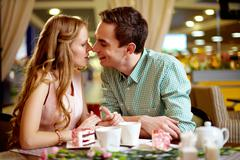 a young happy woman and her boyfriend close to one another - stock photo