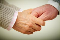 Conceptual image of mature people hands together Stock Photos
