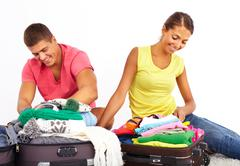 portrait of cute girl and handsome man preparing for journey - stock photo