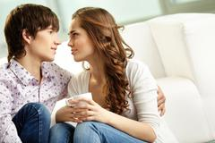 tender couple spending time together indoors and looking at each other with affe - stock photo