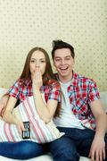 Portrait of young couple during watching tv Stock Photos