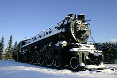 Old locomotive in the snow Stock Photos