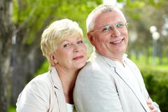 mature woman and her husband having rest outside - stock photo