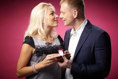 Elegant man making proposal to beautiful woman Stock Photos