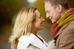 portrait of affectionate couple looking at one another with smiles - stock photo