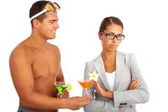 Portrait of topless guy with cocktails giving one to serious businesswoman rejec Stock Photos