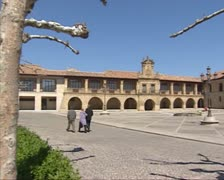 City square with pilgrim hotel, historical buildings - pan Stock Footage