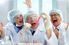 Three extremely emotional scientists being happy about the result of the experim Stock Photos