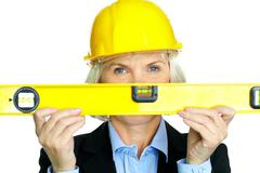 portrait of confident architect with diy tool looking at camera - stock photo