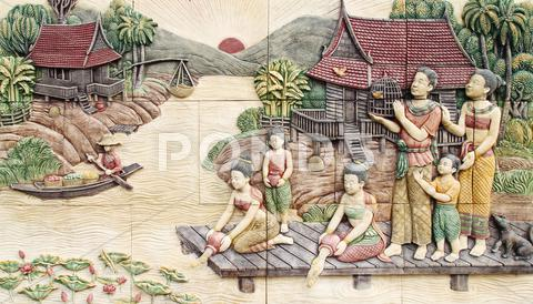 Stock photo of thai culture stone carving on temple wall