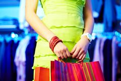 Image of shopaholic hands with three shopping bags Stock Photos