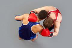 boxing fighters holding each other in a hack - stock photo