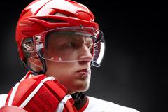 Portrait of a hockey player against black backround Stock Photos