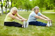 Stock Photo of senior ladies enhancing body flexibility by stretching
