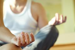 Close-up of feminine and masculine arms during meditation Stock Photos