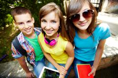 Young students enjoying themselves in the open air Stock Photos