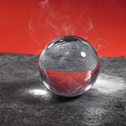 Stock Photo of crystal ball on stone surface