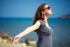 young pretty woman enjoying the sun and the warmth - stock photo