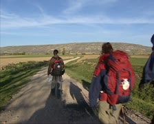Pilgrims walking in Spanish rural landscape at Castrojeriz Stock Footage