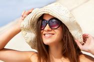 Stock Photo of smiling girl enjoying summer sun and leisure