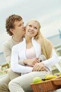 Photo of happy couple flirting outdoors Stock Photos