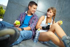 Active young people eating healthy food to stay fit Stock Photos