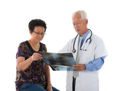 Chinese senior doctor with patient Stock Photos