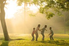 Chinese family having quality time playing at outdoor park Stock Photos