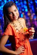 Beautiful african-american woman dressed with elegance enjoying herself at party Stock Photos