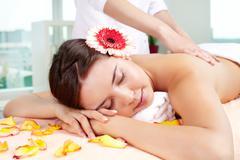 Sweet girl enjoying gentle massaging Stock Photos