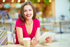 pretty shopper taking repose, shopping being done - stock photo
