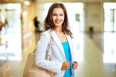 young woman dressed casually projecting confidence and positivity - stock photo