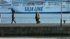 Scandinavia Finland Helsinki pedestrians harbour harbor Stock Footage