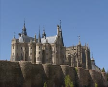 Episcopal Palace of Astorga behind city wall zoom out city park Stock Footage