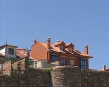 Contemporary buildings on city wall - pan Palace of Astorga Stock Footage