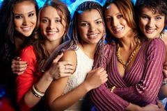 Female friends enjoying themselves at a bridal party Stock Photos