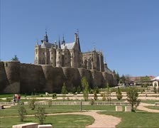 Episcopal Palace of Astorga behind city wall and park Stock Footage