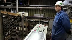 worker in the production of rubber - stock footage