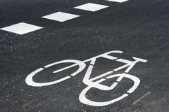 bicycle road sign painted on the tarmac - stock photo