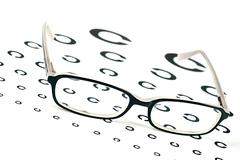 Black glasses on a eye sight test chart Stock Photos